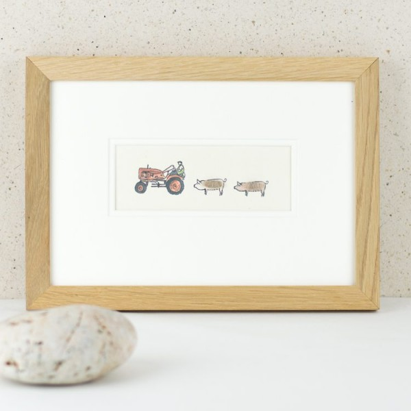 Pigs and vintage tractor picture